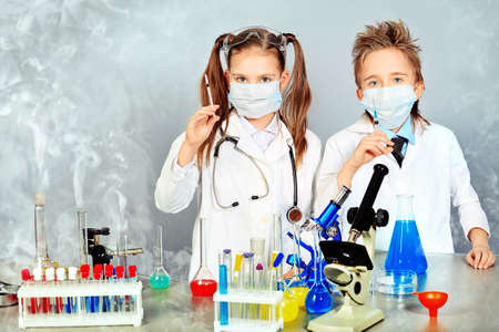 pediatrics: Two children making science experiments. Education.