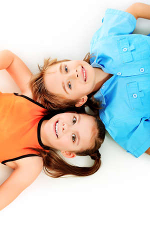 Portrait og two cheerful children. Isolated over white. photo