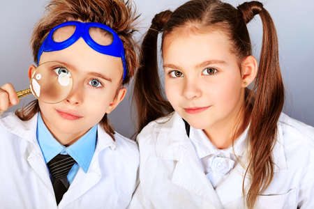 chemistry lesson: Two children making science experiments. Education.