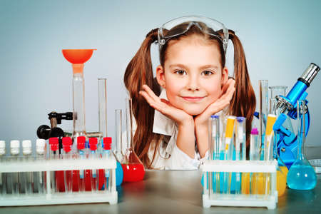 science lesson: Little girl is making science experiments. Education.