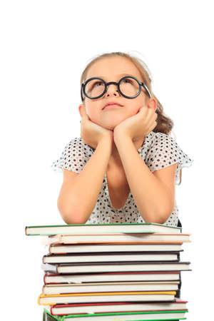 Educación - chica divertida con los libros. Aislado sobre fondo blanco.