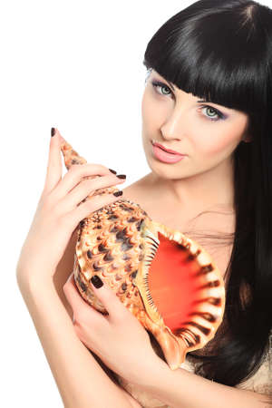 Beautiful young woman posing with marine shell. Spa, healthcare. Isolated over white. photo
