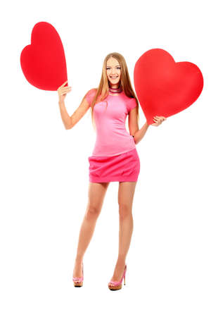 Beautiful young woman posing with red hearts. Isolated over white background. photo