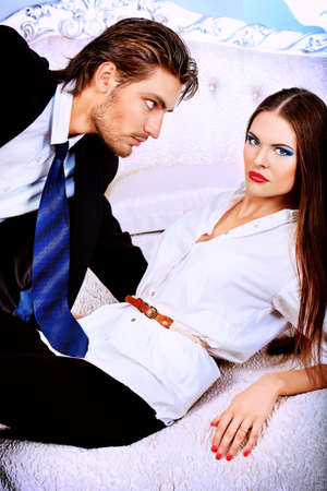 passion couple: Portrait of a handsome fashionable man with  charming woman posing in the interior. Stock Photo