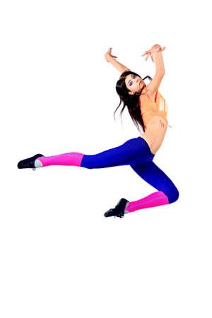 Modern ballet dancer dancing at studio. Isolated over white.  photo