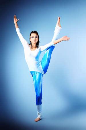 Modern ballet dancer dancing at studio.   photo