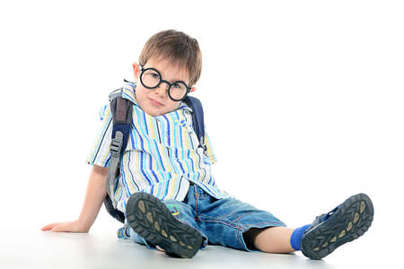 Portrait of a little boy in spectacles. Isolated over white background. Stock Photo - 12266988