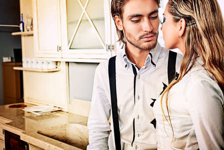 Portrait of a handsome fashionable man with  charming woman posing in the interior. Stock Photo - 12267015