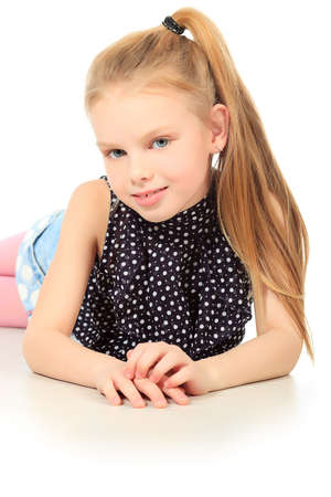 Portrait of a cute 7 years old girl. Isolated over white background. photo