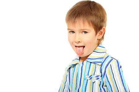 naughty boy: Portrait of a funny 5 years old boy. Isolated over white background. Stock Photo