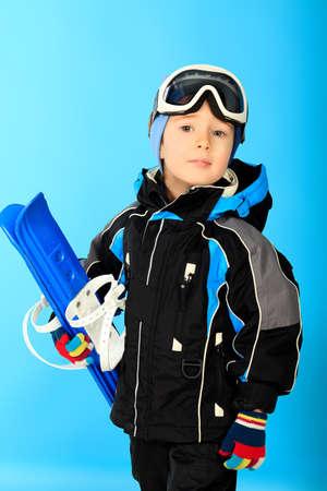 sports wear: Portrait of a little boy in skier suit. Studio shot. Stock Photo