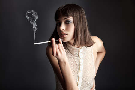 women smoking: Portrait of a female model, fashion shot.