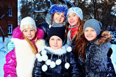 winter fun: Happy children having fun outdoor on winter. Stock Photo