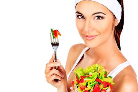 Retrato de una joven y bella mujer comiendo una ensalada de verduras. Aislado sobre fondo blanco. Foto de archivo - 12309055