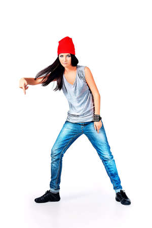 Modern teenage girl dancing hip-hop at studio. Isolated over white background. Stock Photo