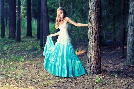 fairy woman: Romantic young woman posing outdoor. Stock Photo