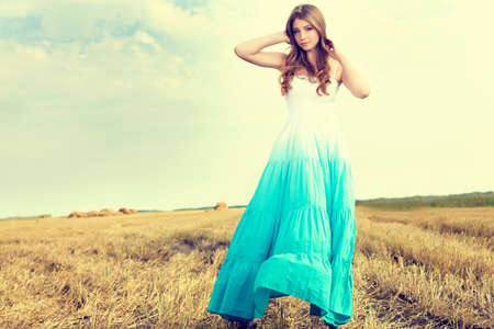 gypsies: Romantic young woman posing outdoor. Stock Photo