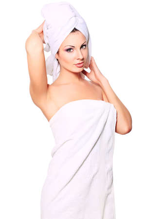 bath cream: Beautiful young woman posing in white towel. Spa, healthcare. Isolated over white.