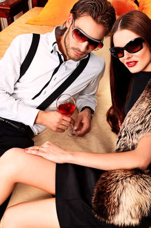 Portrait of a handsome fashionable man with  charming woman posing in the interior. Stock Photo - 12309238