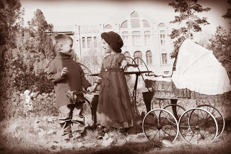 Cute children having a rest at a park. Retro style. photo