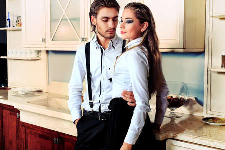 Portrait of a handsome fashionable man with  charming woman posing in the interior. Stock Photo - 12309196