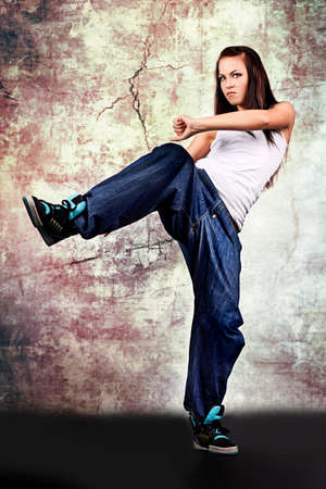 hip hop girl: Modern teenage girl dancing hip-hop at studio.