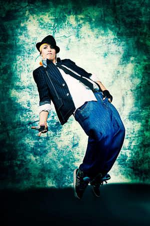 break dance: Modern woman dancing at studio.