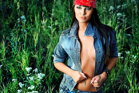 Shot of a sexy woman posing outdoor. Stock Photo