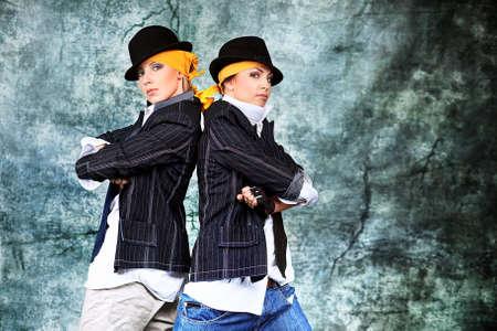 break dance: Two modern woman dancing at studio.