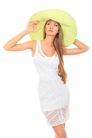 Beautiful young woman in light summer dress posing  over white. Stock Photo