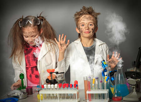 Two children making science experiments. Education. photo