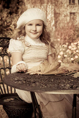 Cute little girl having a rest at a park. Retro style. Stock Photo - 12351517