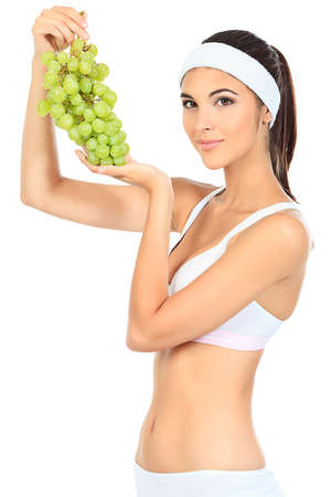 enjoy space: Portrait of a beautiful young woman fresh grapes. Isolated over white background. Stock Photo