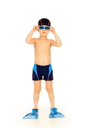 Portrait of a little boy with swimming accessories. Isolated over white. photo