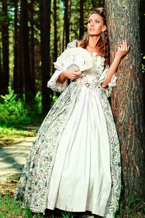 Beautiful young woman in medieval era dress on a sunny day outdoor. Stock Photo - 12521685
