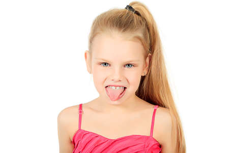 female tongue: Portrait of a funny 7 years old girl. Isolated over white background. Stock Photo