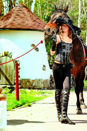 horse show: Beautiful young woman with a horse outdoor.
