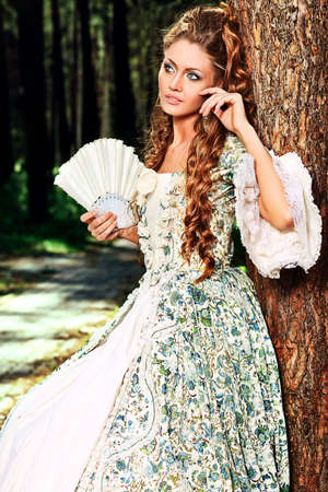 Beautiful young woman in medieval era dress on a sunny day outdoor. Stock Photo - 12521686