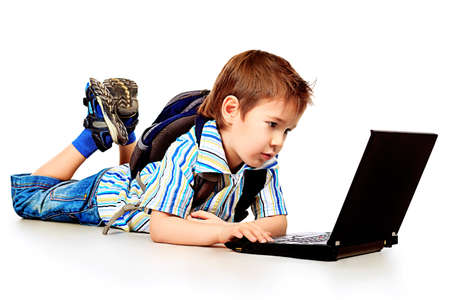 kids laptop: Shot of a boy with his laptop. Isolated over white background.