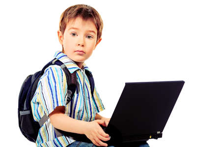 Shot of a boy with his laptop. Isolated over white background. photo