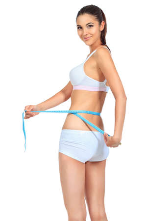body shape: Slender woman measuring her waist. Diet, healthy lifestyle. Stock Photo