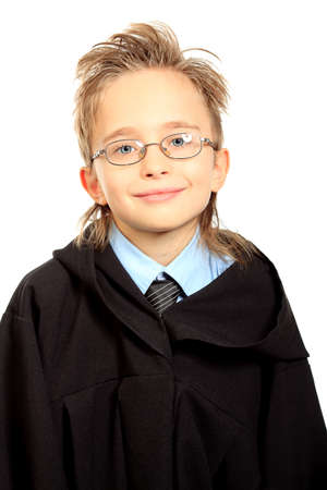 Portrait of a cute boy in a graduation gown. Education. Isolated over white. photo