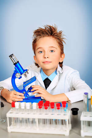Little boy is making science experiments. Education. photo