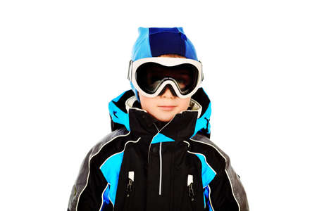 Portrait of a little boy in skier suit. Isolated over white. photo
