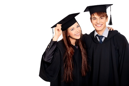 Portrait of two happy graduating students. Isolated over white background.  photo