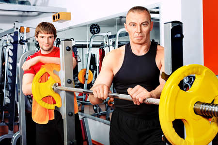 Sporty men in the gym centre. photo