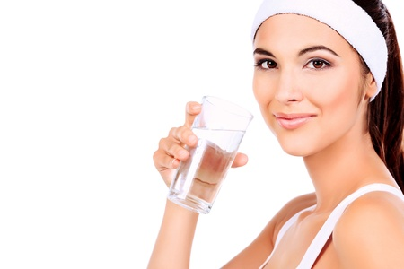 Portrait of a beautiful young woman drinking clear water. Isolated over white background. photo