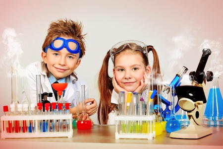 Two children making science experiments. Education. Stock Photo - 12658905