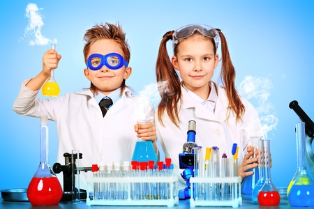 science lesson: Two children making science experiments. Education.