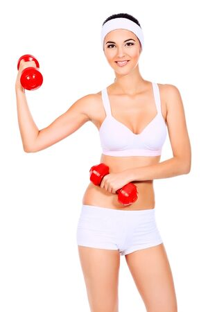 Shot of a sporty young woman with dumbbells. Active sporty life, wellness. Stock Photo - 12658866